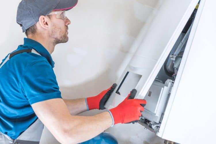 House Heating Unit Repair:condensing boilers, heater, furnace, central heating, gas, repair, fix, installing, installer, technician, job, labor, technology, unit, device, equipment, professional, industry, worker, men, caucasian, household